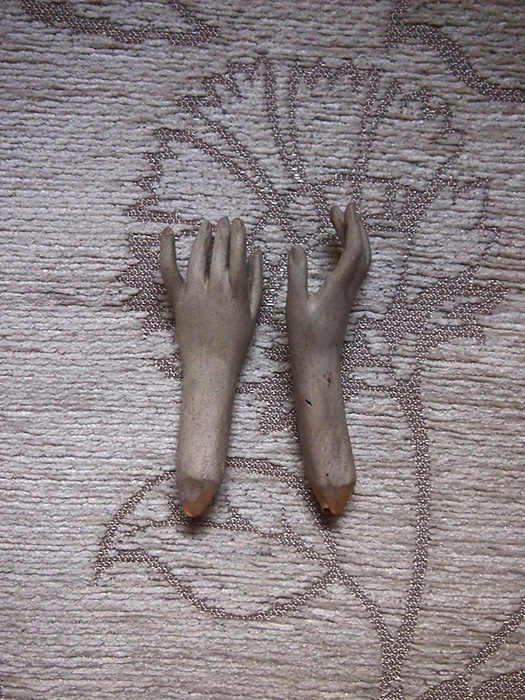 聖人像の腕