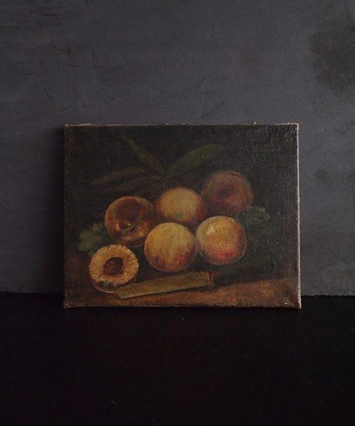 桃とナイフの油彩画
