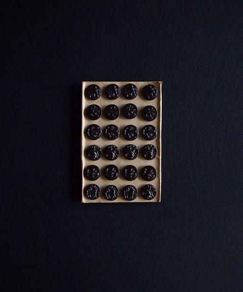 ハンティング・ジャケットのボタン A