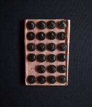 ハンティング・ジャケットのボタン C